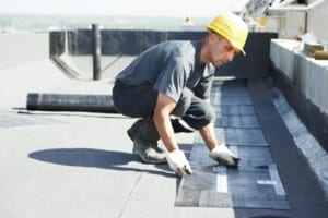 roofer working on flat roof