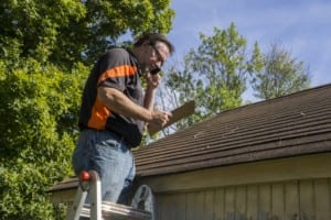 Colorado Springs roofing companies inspect local roof for storm damage