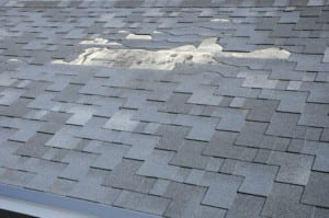 Denver roofing companies inspect and repair damaged roofs